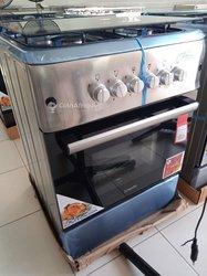 Cuisinière inoxydable avec rôtisseur et minuterie avec allumage automatique, veilleuse et dimensions 60x60