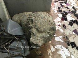 Statue de pierre lion