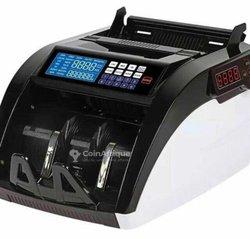 Machine compteur de billets à détecteur automatique