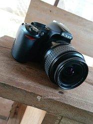 Appareil photo Nikon d3100 - chargeur - batterie - carte mémoire de 1giga