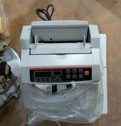 Compteur et détecteur de faux billets