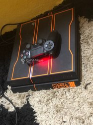 PlayStation 4 - 2 jeux - 1To - 1 manette