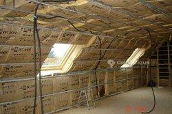 Travaux d'isolation thermique - phonique de bâtiments résidentiels - commerciaux