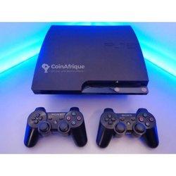 PlayStation 3 slim - 2 manettes crackée