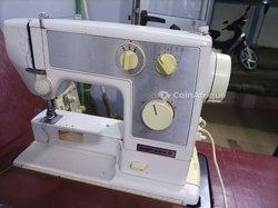 Tête de machine à coudre électronique