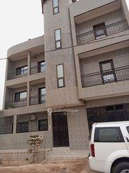 Vente immeuble R+2 -  Zac Mbao